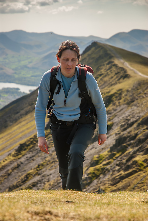A female walker at Scales Tarn and Sharp Edge, Blencathra