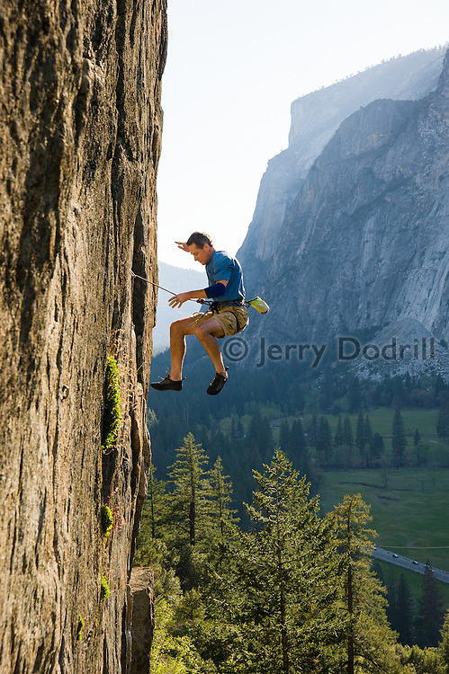 "Tom Addison falling from ""Tucker's Proud Rock Climb,"" 5.12b, Public Sanitation Wall, Yosemite Valley, California."
