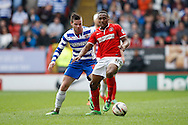 Callum Harriott of Charlton Athletic (R) is challenged by Danny Guthrie of Reading (L) during the Sky Bet Championship match at The Valley, London<br /> Picture by Andrew Tobin/Focus Images Ltd +44 7710 761829<br /> 05/04/2014
