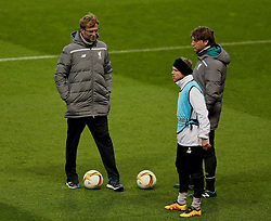 MANCHESTER, ENGLAND - Wednesday, March 16, 2016: Liverpool's manager Jürgen Klopp checks on Alberto Moreno who limps off injured during a training session at Old Trafford ahead of the UEFA Europa League Round of 16 2nd Leg match against Manchester United. (Pic by David Rawcliffe/Propaganda)
