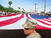 12 NOVEMBER 2007 -- PHOENIX, AZ: US Marine Corps SGT. JASON ROCCO carries an American flag in the Veterans' Day parade in Phoenix, AZ. According the Veterans' Administration, the Veterans' Day Parade in Phoenix, AZ, is the fourth largest Veterans' Day parade in the US. Photo by Jack Kurtz / ZUMA Press