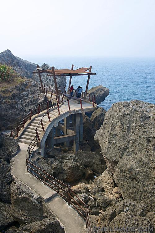 An observation deck on the coastal trail at Black Ghost Cave, on Little Liuqiu Island, Taiwan.