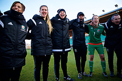 ZENICA, BOSNIA AND HERZEGOVINA - Tuesday, November 28, 2017: Wales' manager Jayne Ludlow, coach John Jackson and goalkeepers Claire Skinner [L] and Laura O'Sullivan [R] celebrate the 1-0 victory over Bosnia and Herzegovina during the FIFA Women's World Cup 2019 Qualifying Round Group 1 match between Bosnia and Herzegovina and Wales at the FF BH Football Training Centre. (Pic by David Rawcliffe/Propaganda)