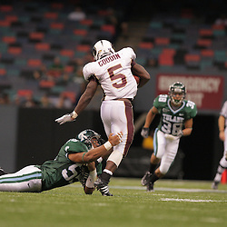 20 September 2008: Tulane linebacker David Kirksey (55) dives to make a tackle on Louisiana-Monroe running back Frank Goodin (5) during a Conference USA match up between the University of Louisiana Monroe and Tulane at the Louisiana Superdome in New Orleans, LA.