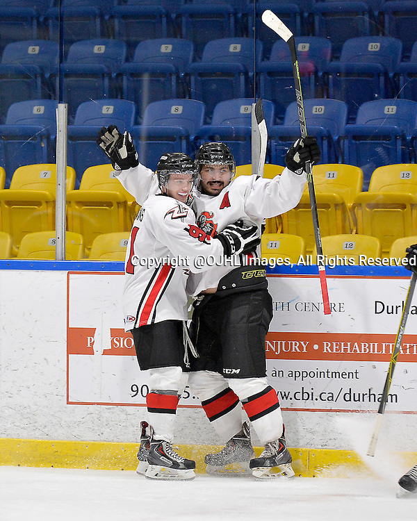 WHITBY, ON - Oct 18, 2015 : Ontario Junior Hockey League game action between Mississauga and Whitby, Stephen Mariani #16 of the Mississauga Chargers celebrates the goal with teammate Brandon Yeamans #91 of the Mississauga Chargers during the second period.<br /> (Photo by Shawn Muir / OJHL Images)