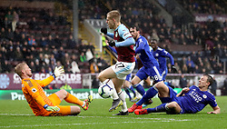 Burnley's Matej Vydra (centre) in action as Leicester City goalkeeper Kasper Schmeichel (left) dives for the ball during the Premier League match at Turf Moor, Burnley.