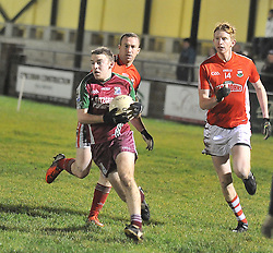 Shrule-Glencorrib's Ross Mellett gets past Garrymore defenders during the South Mayo Junior B final.<br /> Pic Conor McKeown