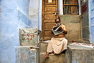 I stopped to photograph this man using an extra pair of specs to read the morning paper in front of his home in Jodhpur, India. For a moment he glanced up at me and I thought the scene would change forever, but fortunately he went right back to what he was doing and allowed me to make this photo.