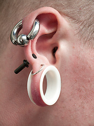 Ear and face piercings