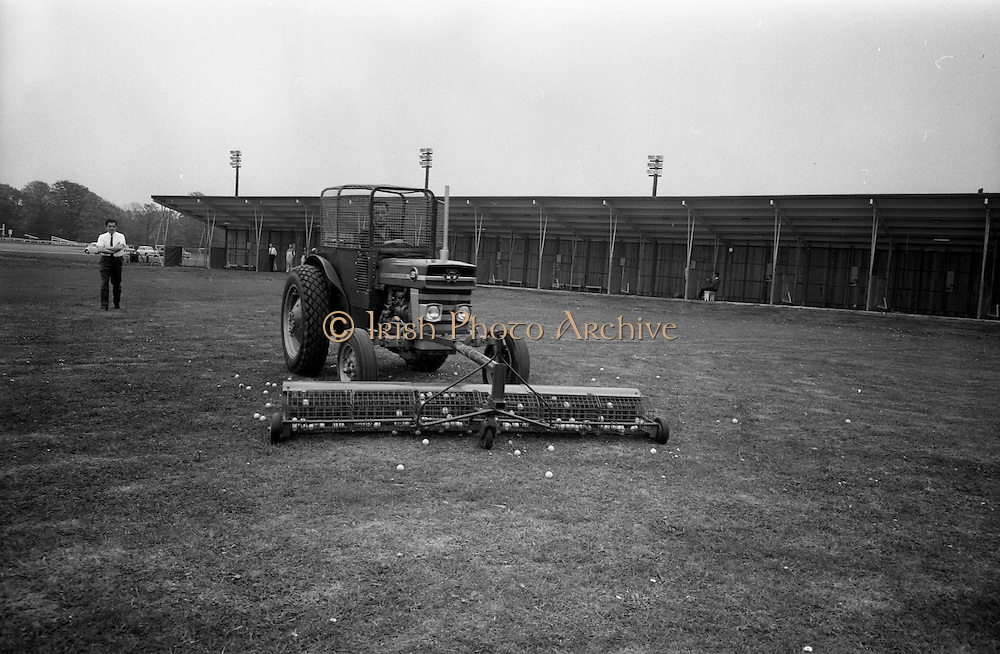 14/05/1965<br /> 05/14/1965<br /> 14 May 1965<br /> New Golf Range at Leopardstown, Foxrock, Dublin. Image shows a Massey Fergusson tractor used to collect balls on the driving range.