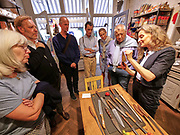 Austria, Vienna. stattGarten EIGENBEDARF concept store. Giselheid Herder-Scholz (r.), director of Windmühlen-Messer (Solingen/Germany) presents her exclusive knives. stattGarten EIGENBEDARF owner Christian Jauernik (2nd from l.) is listening.