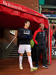 STOKE-ON-TRENT, ENGLAND - Tuesday, January 5, 2016: Liverpool's manager Jürgen Klopp shares a joke with a Stoke City player before the Football League Cup Semi-Final 1st Leg match at the Britannia Stadium. (Pic by David Rawcliffe/Propaganda)
