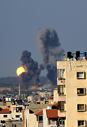 May 4, 2019 - Gaza City, Gaza Strip - Smoke and flames rise following an Israeli airstrike in Gaza city, May 05, 2019. Gaza militants fired a barrage of dozens of rockets at Israel, which responded with strikes that killed a Palestinian on Saturday, officials said, as a fragile ceasefire again faltered. (Credit Image: © Mahmoud Khattab/APA Images via ZUMA Wire)