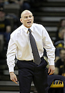 January 29, 2010: Penn State head coach Cael Sanderson yells instructions to Bryan Pearsall in the 133-pound bout at Carver-Hawkeye Arena in Iowa City, Iowa on January 29, 2010. Daniel Dennis won the match 17-7 and Iowa defeated Penn State 29-6.