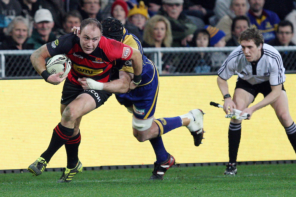 Canterbury's Willie Heinz tries to keep in field in the tackle of Otago's Tom Donnelly in the ITM Cup rugby match, Forsyth Barr Stadium, Dunedin, New Zealand, Saturday, August 27, 2011. Credit:SNPA / Dianne Manson.