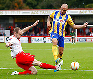 Picture by David Horn/Focus Images Ltd +44 7545 970036<br /> 12/10/2013<br /> David Gray of Stevenage tackles  Alan McCormack of Brentford just inside the penalty box during the Sky Bet League 1 match at the Lamex Stadium, Stevenage.