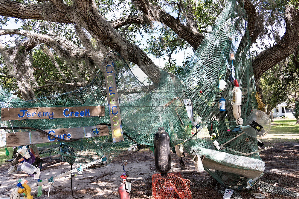 A sculpture made from waste and trash washed up in Jeremy Creek hangs from a live oak tree in the tiny hamlet of McClellanville, South Carolina. McClellanville is a tiny fishing village inside the Cape Romain National Wildlife Refuge and surrounded by Francis Marion National Forest.