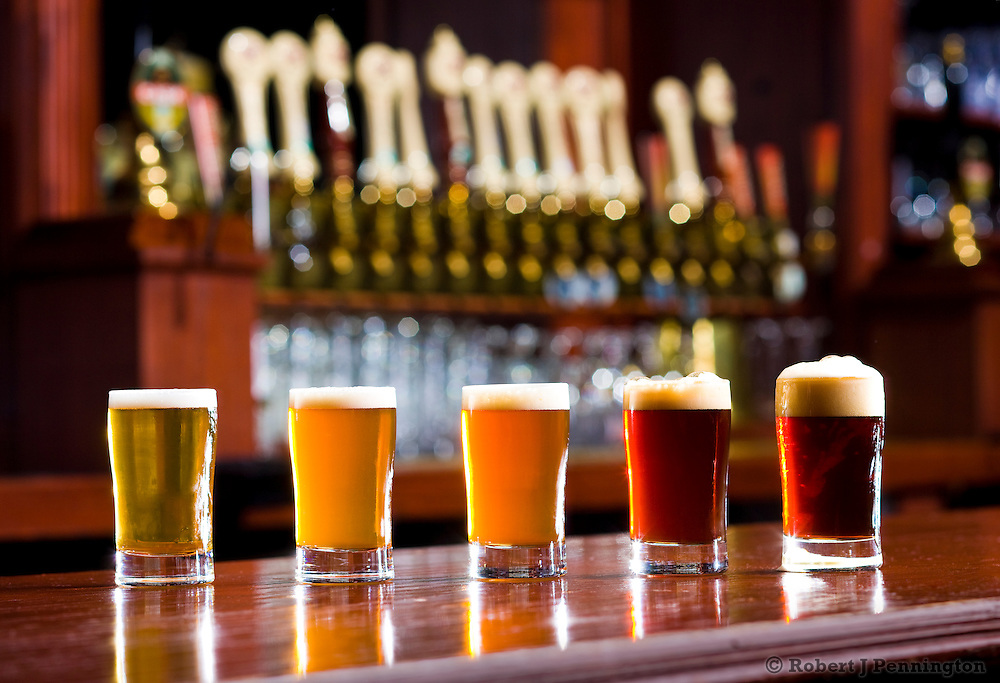 Samples of Beer on a bar in a Brew Pub.