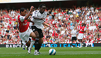 Photo: Steve Bond.<br />Arsenal v Derby County. The FA Barclays Premiership. 22/09/2007. Theo Walcott (L) is tackled by Claude Davis (R)