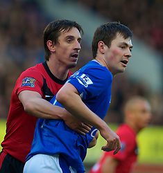 LIVERPOOL, ENGLAND - Saturday, February 20, 2010: Manchester United's captain Gary Neville grabs hold of Everton's Diniyar Bilyaletdinov during the Premiership match at Goodison Park. (Photo by: David Rawcliffe/Propaganda)