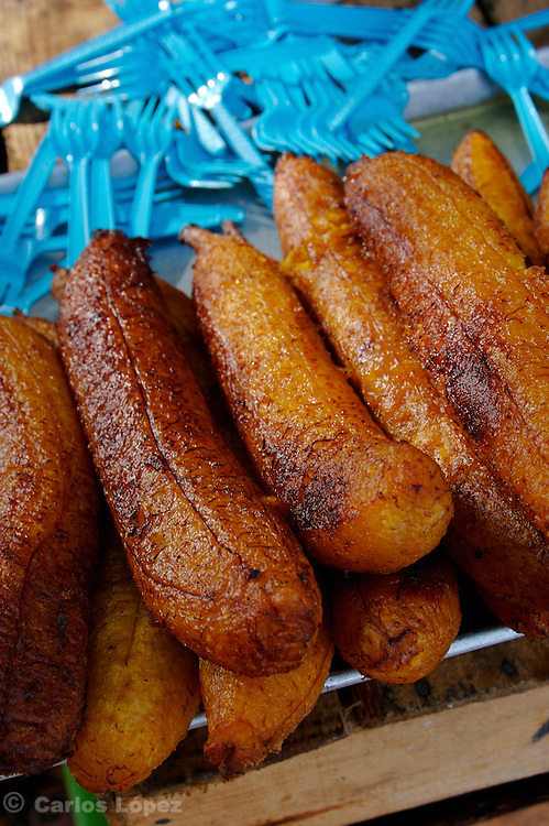 "A group of fried bananas called ""machos"" for sale  in a street market of mexico."