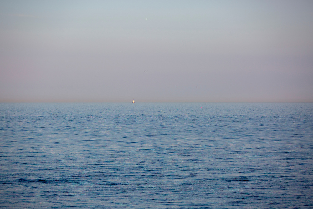 A white sailed yacht sits on the horizon in the English Channel from Folkestone, Kent, England, United Kingdom.  (photo by Andrew Aitchison / In pictures via Getty Images)