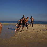 Locals play football on Sao Conrado beach, Rio de Janeiro, Brazil. 8th July 2010. Photo Tim Clayton..