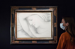 "© Licensed to London News Pictures. 23/07/2020. LONDON, UK. A staff member views ""Femme endormie (1931) by Pablo Picasso, estimate: £6-9 million. Preview of works on display at Sotheby's London ahead of a one-off auction on July 28.  Titled 'Rembrandt to Richter', the sale will offer the very best from Old Masters, Impressionist & Modern Art, Modern & Post-War British Art and Contemporary Art.  The exhibition is open to the public at Sotheby's New Bond Street galleries until July 28. [Image embargoed for release until 9am BST 24 July 2020].  Photo credit: Stephen Chung/LNP"