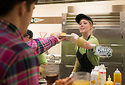 Hannah Haseman hands an Ohio University student his freshly cooked omlete in Nelson Dining Hall. Photo by Olivia Wallace