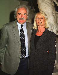 TV presenter DES LYNAM and MISS ROSE DIAMOND, at a party in London on 18th May 1999.MSE 30