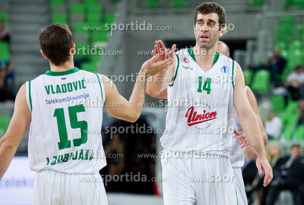 Jakov Vladovic #15 of KK Union Olimpija and Drazen Bubnic #14 of KK Union Olimpija  during basketball match between KK Union Olimpija Ljubljana and Asvel Villeurbanne Basket (FRA) in Round 7 of EuroCup 2013/14, on November 27, 2013 in Arena Stozice, Ljubljana, Slovenia. Photo by Vid Ponikvar / Sportida
