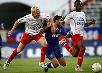 Photo: Maarten Straetemans.<br /> Royal Antwerp v Ipswich Town. Pre Season Friendly. 31/07/2007.<br /> Pablo Counago goes down between two Antwerp players