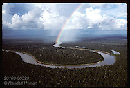 Rainbow arches over Jurua River during late pm rain in Amazonas near Eirunepe; aerial,horizontal Brazil