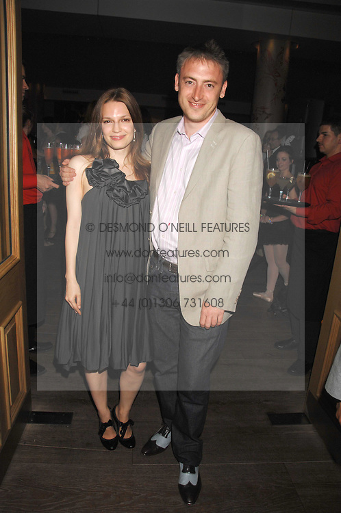 ZOE MANZI and LUKE LEACH at a party to celebrate the launch of the Boodles Wonderland jewellery collection held at the Haymarket Hotel, 1 Suffolk Place, London on 9th June 2008.<br />