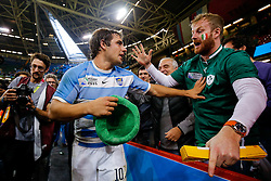 Argentina's Man of the Match Nicolas Sanchez holds back an Ireland fan after Argentina win the match - Mandatory byline: Rogan Thomson/JMP - 07966 386802 - 18/10/2015 - RUGBY UNION - Millennium Stadium - Cardiff, Wales - Ireland v Argentina - Rugby World Cup 2015 Quarter Finals.