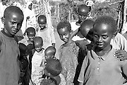 Children at the Hagadera refugee camp near Dadaab, Kenya, form about half the population of 60,000 residents. Many of these children have spent their entire lives living at the camp which was established in 1992. The camp is administered by the United Nations High Commission for Refugees.