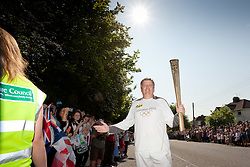 © Licensed to London News Pictures. 23/05/2012. CHIPPENHAM, UNITED KINGDOM. Marathon running fireman Rob Warwick waits for the arrival of the Flame atthe start of the Chippenham stage of the Olympic Torch relay in Wiltshire on Day 4 of the round Britain procession. Photo credit: Mark Chappell/LNP