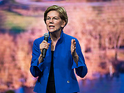 01 NOVEMBER 2019 - DES MOINES, IOWA: US Senator ELIZABETH WARREN (D-MA), a candidate for president, speaks at the Liberty and Justice Celebration in the Wells Fargo Arena in Des Moines. The Liberty and Justice Celebration is a fund raiser for the Iowa Democratic Party. Many of the Democratic candidates for the US presidency spoke at the 2019 Celebration. Iowa holds the first presidential selection event of the 2020 election cycle. The Iowa Caucuses are Feb. 3, 2020.            PHOTO BY JACK KURTZ
