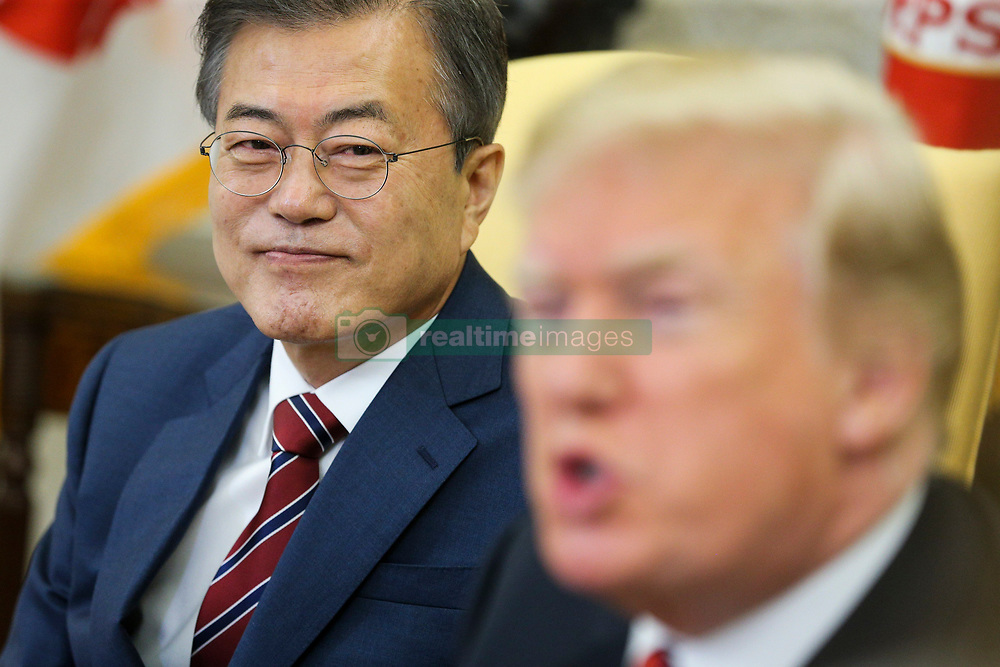 United States President Donald J. Trump speaks as South Korean President Moon Jae-in listens during a meeting in the Oval Office of the White House on May 22, 2018 in Washington DC. Credit: Oliver Contreras / Pool via CNP. 22 May 2018 Pictured: South Korean President Moon Jae-in listens as United States President Donald J. Trump speaks during a meeting in the Oval Office of the White House on May 22, 2018 in Washington DC. Credit: Oliver Contreras / Pool via CNP. Photo credit: Oliver Contreras - Poll via CNP / MEGA TheMegaAgency.com +1 888 505 6342