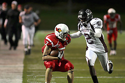 25 September 2010:  Ben Ericksen eyes defender Howard Scarborough as he nears the goal line.  The Missouri State Bears lost to the Illinois State Redbirds 44-41 in double overtime, meeting at Hancock Stadium on the campus of Illinois State University in Normal Illinois.