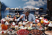 Harry Fujita, president and CEO of Iwasaki Images of America, shows samples of the plastic food and novelty items his Torrance, California company makes. MODEL RELEASED.
