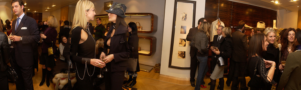Prince Casimir zu Sayn Wittgenstein , ( blue tie) Amanda Ajram, Prince Casimir zu Sayn Wittgenstein  and emma Langwith,  Jonathan Newhouse in group on rightOpening of a Tod's boutique, Old Bond St. 19 Nov 2003. © Copyright Photograph by Dafydd Jones 66 Stockwell Park Rd. London SW9 0DA Tel 020 7733 0108 www.dafjones.com