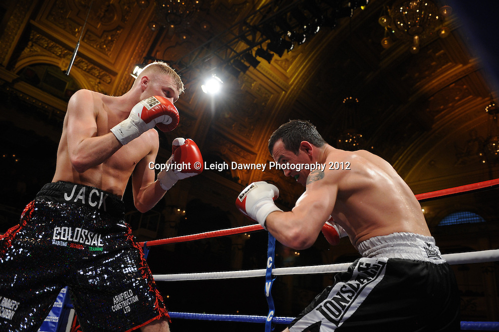 Jack Arnfield (black/red shorts) defeats Kevin McCauley in a Light Middleweight  contest at The Winter Gardens, Blackpool on the 31st March 2012. Frank Maloney and Steve Wood VIP Promotions. © Leigh Dawney Photography 2012.