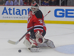 May 30; Newark, NJ, USA; New Jersey Devils goalie Martin Brodeur (30) makes a save during the first period of 2012 Stanley Cup Finals Game 1 at the Prudential Center.  The Kings defeated the Devils 2-1.