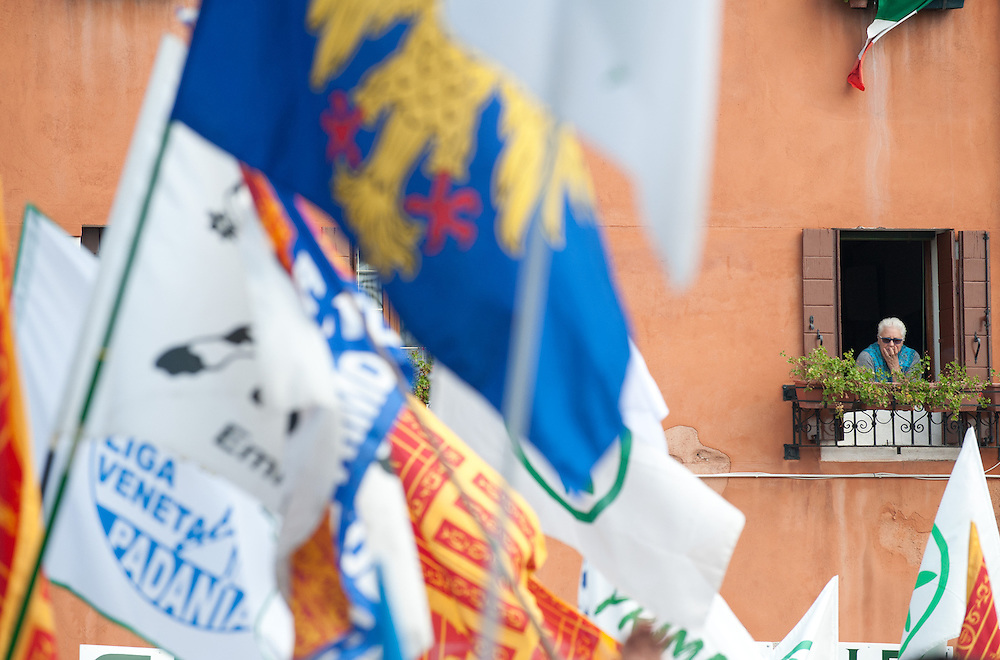 "An old lady looks from her window  during today Lega Nord rally in Venice under the slogan ""Prima Il Nord""  (North First)  the Lega Nord with its new Secretary Roberto Maroni are trying to go back to their  1996 meeting in Venice with its original federalist credo"