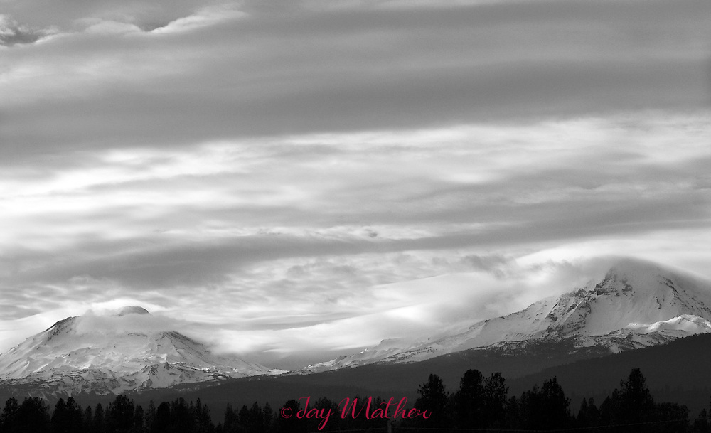 Storm clouds move over the Cascade mountains near Sisters, Oregon.