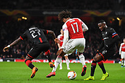 Arsenal Midfielder Alex Iwobi (17) keeps possession against Rennes Hamari Traore (27) and Rennes James Lea Siliki (12) during the Europa League round of 16, leg 2 of 2 match between Arsenal and Rennes at the Emirates Stadium, London, England on 14 March 2019.