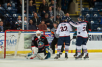 KELOWNA, CANADA - DECEMBER 5: Nolan Yaremko #22 and Parker AuCoin #32 of the Tri-City Americans celebrate a second period goal on James Porter #1 of the Kelowna Rockets  on December 5, 2018 at Prospera Place in Kelowna, British Columbia, Canada.  (Photo by Marissa Baecker/Shoot the Breeze)