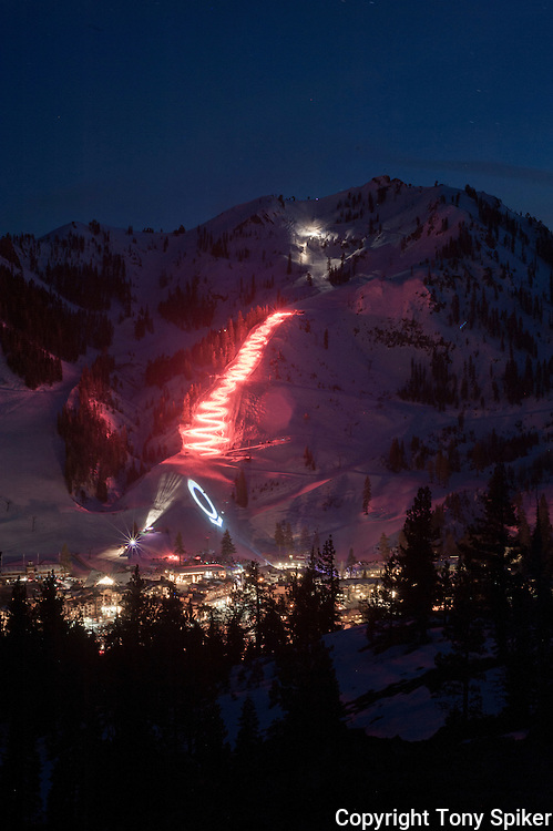 """Squaw Valley Torchlight Parade 1"" - Skiers participate in a torchlight parade down KT-22 as part of opening ceremonies for Snowfest"
