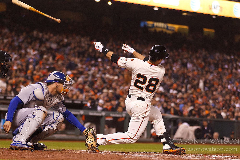 SAN FRANCISCO, CA - MAY 20:  Buster Posey #28 of the San Francisco Giants loses control of his bat during the sixth inning against the Los Angeles Dodgers at AT&T Park on May 20, 2015 in San Francisco, California.  (Photo by Jason O. Watson/Getty Images) *** Local Caption *** Buster Posey
